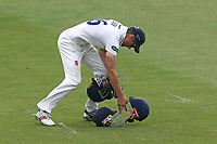 Alastair Cook of Essex gathers up four helmets during Essex CCC vs Warwickshire CCC, Specsavers County Championship Division 1 Cricket at The Cloudfm County Ground on 22nd June 2017