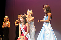Miss Mississippi State University Hannah Oliver, a senior fashion merchandising major from Stuttgart, Arkansas, is crowned by 2018 Miss MSU Callie Brown of Lucedale while reigning Miss Mississippi Asya Branch, right, and other contestants look on. <br />  (photo by Beth Wynn / &copy; Mississippi State University)