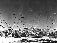 Men and equipment being parachuted to earth in an operation conducted by United Nations airborne units. Ca.  1951. Defense Dept. (USIA)<br /> Exact Date Shot Unknown<br /> NARA FILE #:  306-PS-51-5924<br /> WAR & CONFLICT BOOK #:  1429