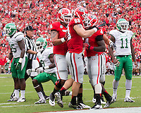 The Georgia Bulldogs played North Texas Mean Green at Sanford Stadium.  After North Texas tied the game at 21 early in the second half, the Georgia Bulldogs went on to score 24 unanswered points to win 45-21.  Georgia Bulldogs tight end Arthur Lynch (88) celebrates the touchdown with Georgia Bulldogs running back Keith Marshall (4)