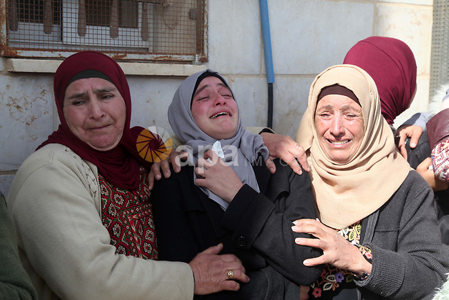 Relatives of Hamdi Naasan during his funeral in al-Mughair mourn during his funeral in al-Mughair village near the West Bank city of Ramallah, January 27, 2019.  Nassan was shot killed in clashes with Israeli settlers, Palestinians said, The settlers say a Jewish man was stabbed by Palestinians and they fired in the air while chasing away the attackers. Photo by Ahmad Arouri