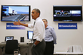 United States President Barack Obama tours the The Federal Highway Administration's Turner-Fairbank Highway Research Center July 15, 2014 in McLean, Virginia. According to the Department of Transportation, the center is home to '20 laboratories, data centers, and support facilities, and conducts applied and exploratory advanced research in vehicle-highway interaction, nanotechnology, and a host of other types of transportation research in safety, pavements, highway structures and bridges, human-centered systems, operations and intelligent transportation systems, and materials.' <br /> Credit: Chip Somodevilla / Pool via CNP