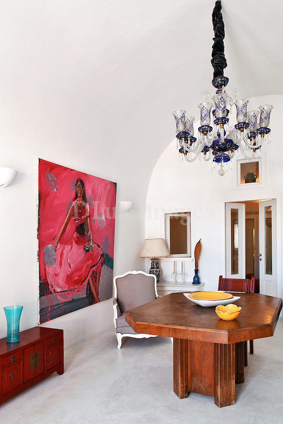 red artwork in the dining room