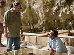 Wahyu Saptomo and Thomas Sutika, from ARKENAS, discuss progress at eh Liang Bua dig site.