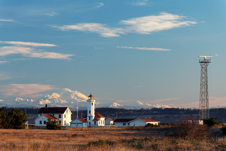 Point Wilson Lighthouse and snowy Mount Baker at sunrise, Fort Worden State Park, Port Townsend, Jefferson County, Washington, USA