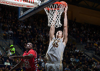 David Kravish of California dunks the ball during the game against Fresno State at Haas Pavilion in Berkeley, California on December 14th, 2013.  California defeated Fresno State, 67-56.