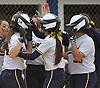 Sydney Tamburello #24 of Massapequa gets congratulated after connecting for a two-run home run to right field in the top of the fourth inning of Game 2 of the Nassau County varsity softball Class AA semifinals against host East Meadow High School on Tuesday, May 17, 2016.