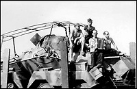 BNPS.co.uk (01202 558833)Pic:    Pen&Sword/BNPS<br /> <br /> An Afrika Korps crew sitting on one of their vehicles while a crew member plays an accordion.<br /> <br /> Fascinating rare photos of Rommel's feared Afrika Korps which terrorised the Allies in the desert have come to light in a new book.<br /> <br /> Under the direction of legendary German commander Field Marshal Erwin Rommel, who was nicknamed the Desert Fox, the corps were recognised as a superb fighting machine.<br /> <br /> They achieved their greatest triumph when they outmanoeuvred the British at the Battle of Gazala in June 1942 which led to them capturing Tobruk in Libya.<br /> <br /> But they were ultimately defeated in the iconic Battle of Alamein when they succumbed to an offensive led by Field Marshal Bernard Montgomery.