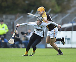 Ger O Connell of Clonlara in action against Gary Brennan of Ballyea during their senior county final replay at Cusack Park. Photograph by John Kelly.
