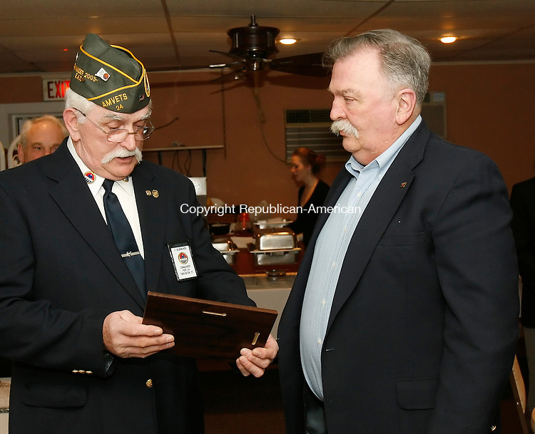 TORRINGTON, CT, 02/12/08- 021209BZ04- Frank Dlugokinski, AMVETS Post 24 commander, left, presents the Post 24 AMVET of the Year award to John R. Harrison during their annual awards ceremony at Dick's Restaurant Thursday night.<br /> Jamison C. Bazinet Republican-American