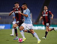 Calcio, Serie A: Lazio vs Bologna. Roma, stadio Olimpico, 22 agosto 2015.<br /> Lazio&rsquo;s Felipe Anderson is challenged by Bologna&rsquo;s Alex Ferrari, left, during the Italian Serie A football match between Lazio and Bologna at Rome's Olympic stadium, 22 August 2015.<br /> UPDATE IMAGES PRESS/Isabella Bonotto