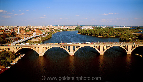 Washington DC aerial overlooking Francis Scott Key Bridge and the Potomac River.  Georgetown is on the left.