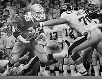 Sept. 1986 -- 2:48 in the first. Long pass intercepted by Ohio State's Chris Spielman. Columbus Dispatch photo by Tim Revell