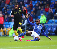29th February 2020; Cardiff City Stadium, Cardiff, Glamorgan, Wales; English Championship Football, Cardiff City versus Brentford; Leandro Bacuna of Cardiff City slides in to tackle Said Benrahma of Brentford