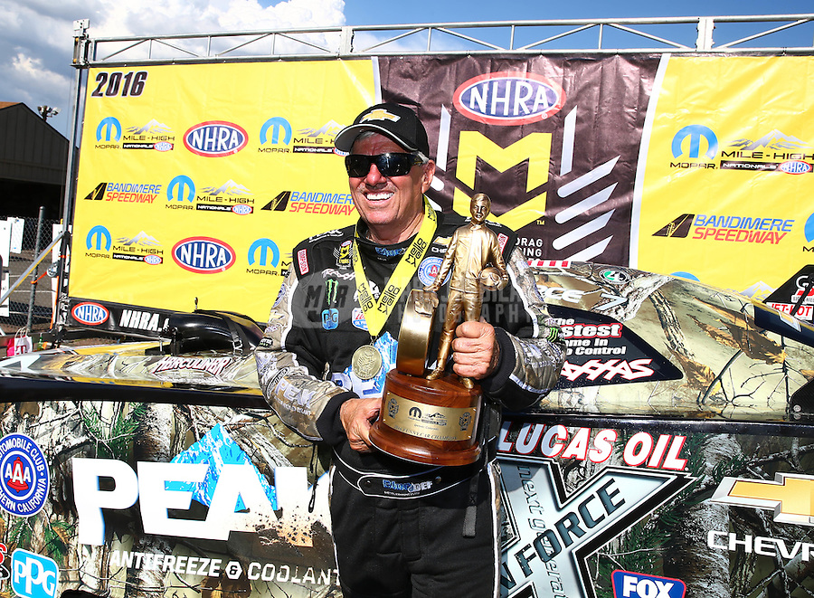 Jul 24, 2016; Morrison, CO, USA; NHRA funny car driver John Force celebrates after winning the Mile High Nationals at Bandimere Speedway. Mandatory Credit: Mark J. Rebilas-USA TODAY Sports
