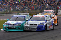 Round 9 of the 2002 British Touring Car Championship. #15 David Leslie (GBR). Petronas Syntium Proton. Proton Impian. #111 Aaron Slight (NZL). Barwell Motorsport. Vauxhall Astra Coupé.
