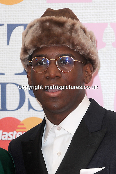 NON EXCLUSIVE PICTURE: PAUL TREADWAY / MATRIXPICTURES.CO.UK<br /> PLEASE CREDIT ALL USES<br /> <br /> WORLD RIGHTS<br /> <br /> English singer-songwriter Labrinth attending the BRIT Awards 2015 at the O2 Arena, in London.<br /> <br /> FEBRUARY 25th 2015<br /> <br /> REF: PTY 15627