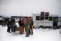 People gather around vendors' trailers at the Whitefish Skijoring World Championship event in Whitefish, Montana, USA.  Skijoring is a competitive sport in which a person on skis navigates an obstacle course while being pulled behind a galloping horse.