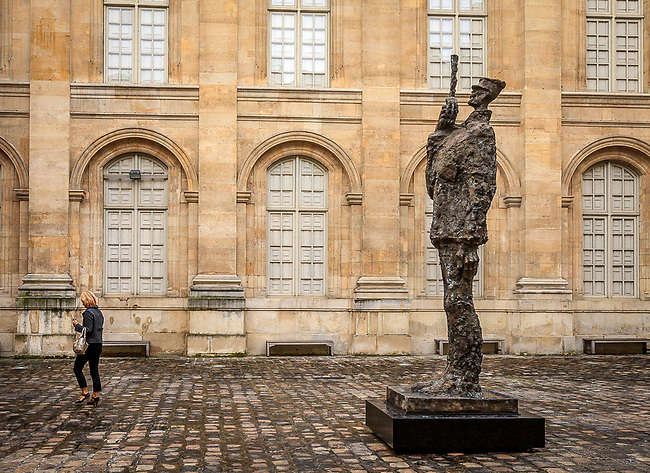 Today, a copy of the statue of Dreyfus holding his broken sword stands at the entrance to the Museum of Jewish Art and History in Paris. The original can be found at Boulevard Raspail, n&deg;116&ndash;118, at the exit of the Notre-Dame-des-Champs metro station.     Honoring a delayed debt to a soldier it disgraced almost 100 years ago, France on 6/9/88 put up a controversial bronze statue of Capt. Alfred Dreyfus in the Tuileries Gardens of Paris.   The Dreyfus affair (French: l'affaire Dreyfus, pronounced: [la.fɛʁ dʁɛ.fys]) was a political scandal that divided France from its beginning in 1894 until it was finally resolved in 1906. The affair is often seen as a modern and universal symbol of injustice,[1] and remains one of the most striking examples of a complex miscarriage of justice, where a major role was played by the press and public opinion.<br /> <br /> The scandal began in December 1894, with the treason conviction of Captain Alfred Dreyfus, a young French artillery officer of Alsatian and Jewish descent. Sentenced to life imprisonment for allegedly communicating French military secrets to the German Embassy in Paris, Dreyfus was imprisoned on Devil's Island in French Guiana, where he would spend nearly five years.<br /> <br /> Evidence came to light in 1896&mdash;primarily through an investigation instigated by Georges Picquart, head of counter-espionage&mdash;identifying a French Army major named Ferdinand Walsin Esterhazy as the real culprit. After high-ranking military officials suppressed the new evidence, a military court unanimously acquitted Esterhazy after a trial lasting only two days. The Army then accused Dreyfus of additional charges based on falsified documents. Word of the military court's framing of Dreyfus and of an attempted cover-up began to spread, chiefly owing to J'accuse, a vehement open letter published in a Paris newspaper in January 1898 by famed writer &Eacute;mile Zola. Activists put pressure on the government to reopen the case.