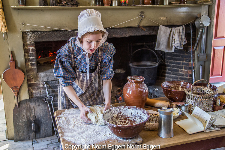 Woman cooking in the Freeman Farm kitchen at OSV