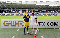 Pictured L-R: Players Ben Davies wearing the away kit and Leon Britton with the home kit, at the official launch of the 2013-2014 Swansea City Football Club kit launch at the Liberty Stadium, Swansea, south Wales. Friday 28th of June 2013