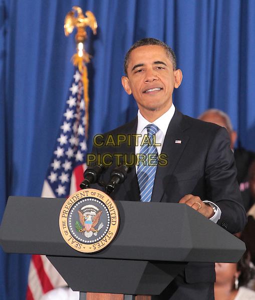 U.S. President Barack Obama speaks at Yeadon Regional Head Start Center in Yeadon, Pennsylvania, USA..November 8th,  2011.half length black suit jacket podium speech blue tie.CAP/RKE/EML.©EML/RockinExposures/Capital Pictures.