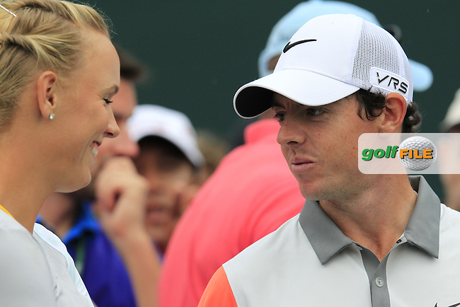 Rory McIlroy (NIR) and Caroline Wozniacki wait at the 17th tee during Sunday's Final Round of the Omega Dubai Desert Classic 2014 held at the Emirates Golf Club, Dubai. 2nd February 2014.<br /> Picture: Eoin Clarke www.golffile.ie