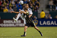 LA Galaxy defender Leonardo battle with Columbus Crew forward Guillermo Barros Schelotto. The LA Galaxy defeated the Columbus Crew 3-1 at Home Depot Center stadium in Carson, California on Saturday Sept 11, 2010.