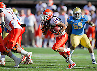 SAN FRANCISCO, CA - December 31, 2011: Illinois running back Troy Pollard (28) competes against UCLA at AT&T Park in San Francisco, California. Final score Illinois wins 20-14.