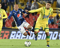BOGOTA - COLOMBIA, 03-02-2019: Juan David Perez de Millonarios disputa el balón con Cesar Quintero de Bucaramanga durante partido por la fecha 3 de la Liga Águila I 2019 entre Millonarios y Atlético Bucaramanga jugado en el estadio Nemesio Camacho El Campin de la ciudad de Bogotá. / Juan David Perez of Millonarios fights for the ball with Cesar Quintero of Bucaramanga during match for the date 3 of the Liga Aguila I 2019 between Millonarios and Atletico Bucaramanga played at the Nemesio Camacho El Campin Stadium in Bogota city. Photo: VizzorImage / Gabriel Aponte / Staff.