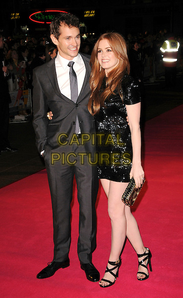 "HUGH DANCY & ISLA FISHER .UK Premiere of ""Confessions of a Shopaholic"" at the Empire Cinema, Leicester Square, London, .February 16th 2009.full length black beaded dress mini patent shoes sandals clutch bag grey gray suit tie .CAP/CAS.©Bob Cass/Capital Pictures"