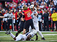 College Park, MD - NOV 11, 2017: Maryland Terrapins quarterback Max Bortenschlager (18) throws from the pocket with pressure from Penn State Nittany Lions defensive end Yetur Gross-Matos (99) and Nittany Lions defensive end Shane Simmons (34) during game between Maryland and Penn State at Capital One Field at Maryland Stadium in College Park, MD. (Photo by Phil Peters/Media Images International)