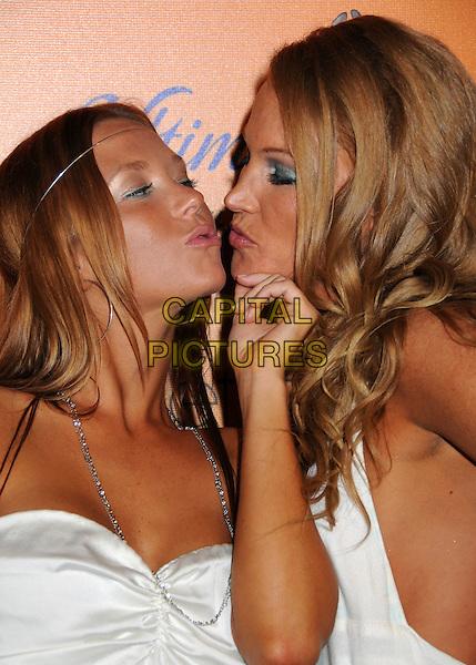 "SARA KOVA & ERIN TIETSORT.""Sunset Tan"" Season 2 Premiere Party at Les Deux, Hollywood, California, USA..July 30th, 2008.headshot portrait kiss kissing .CAP/ADM/BP.©Byron Purvis/AdMedia/Capital Pictures."