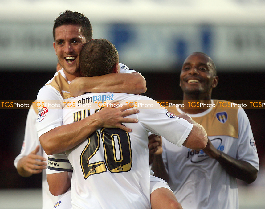 Brian Wilson of Colchester United is congratulated after scoring the opening goal - Dagenham and Redbridge vs Colchester United at the London Borough of Barking and Dagenham Stadium - 03/09/13 - MANDATORY CREDIT: Dave Simpson/TGSPHOTO - Self billing applies where appropriate - 0845 094 6026 - contact@tgsphoto.co.uk - NO UNPAID USE