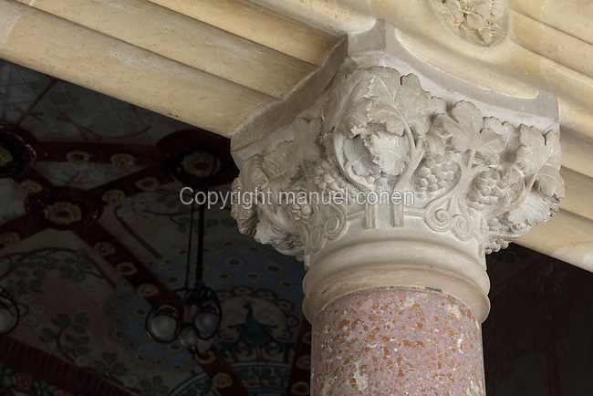 Carved stone capital with vine design, on a column in the double-height living room, in Pavilion no. 6 'dels distingits' of the Institut Pere Mata, a psychiatric hospital built 1897-1912 in Modernist style by Lluis Domenech i Montaner, 1850-1923, Catalan Modernist architect, in Reus, Catalonia, Spain. Pavilion no. 6 was used to house wealthy patients in great comfort and modernity, and was in use until 1986. It is now open to the public as part of Reus' Modernist Route and run by the town of Reus, whereas the rest of the building remains a hospital. The building is listed as a Cultural Asset of National Interest. Picture by Manuel Cohen