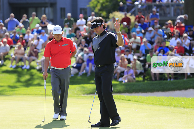 Jason Dufner and Bubba Watson (USA) on the 16th green during Saturday's Round 3 of the 2013 Bridgestone Invitational WGC tournament held at the Firestone Country Club, Akron, Ohio. 3rd August 2013.<br /> Picture: Eoin Clarke www.golffile.ie