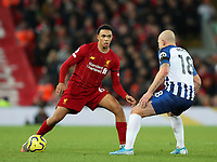 30th November 2019; Anfield, Liverpool, Merseyside, England; English Premier League Football, Liverpool versus Brighton and Hove Albion; Trent Alexander-Arnold of Liverpool takes on Aaron Mooy of Brighton and Hove Albion - Strictly Editorial Use Only. No use with unauthorized audio, video, data, fixture lists, club/league logos or 'live' services. Online in-match use limited to 120 images, no video emulation. No use in betting, games or single club/league/player publications