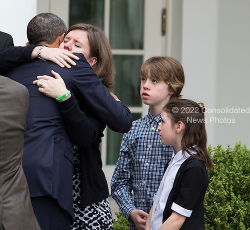 United States President Barack Obama hugs Jackie Barden, as her children Natalie and James look on, after delivering a statement after gun legislation failed in Congress, in the Rose Garden at the White House, in Washington, Wednesday, April 17, 2013. The president was accompanied by Vice President Joe Biden, former Rep. Gabby Giffords and family members from Newtown. .Credit: Drew Angerer / Pool via CNP