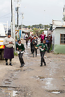South Africa, Cape Town.  Students Going Home from School in a  Guguletu Township Street.