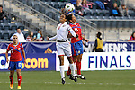 24 October 2014: Maylee Attin (TRI) (9) and Raquel Rodriguez Cedeno (CRC) (11) challenge for a header. The Costa Rica Women's National Team played the Trinidad & Tobago Women's National Team at PPL Park in Chester, Pennsylvania in a 2014 CONCACAF Women's Championship semifinal game, which serves as a qualifying tournament for the 2015 FIFA Women's World Cup in Canada. Costa Rica advanced to the championship game, and qualified for next year's Women's World Cup, by winning the penalty shootout 3-0 after the game ended in a 1-1 tie after double overtime.