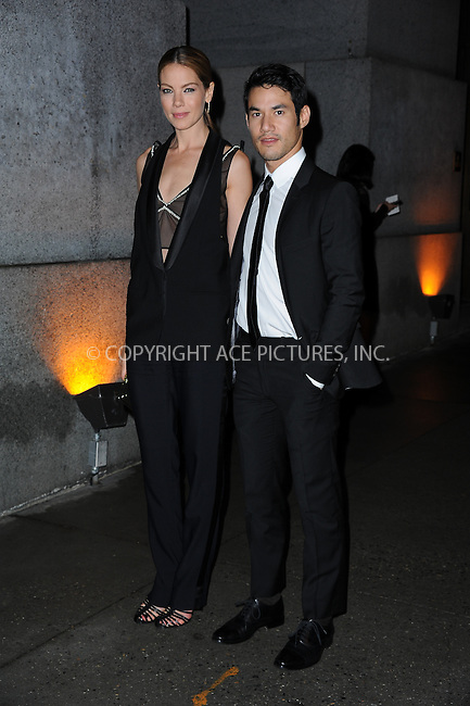 ACEPIXS.COM<br /> <br /> October 23 2014, New York City<br /> <br /> Michelle Monaghan and Joseph Altuzarra arriving at Fashion Group International's 31st Annual Night of Stars: The Protagonists at Cipriani Wall Street on October 23, 2014 in New York City.<br /> <br /> By Line: William Bernard/ACE Pictures<br /> <br /> ACE Pictures, Inc.<br /> www.acepixs.com<br /> Email: info@acepixs.com<br /> Tel: 646 769 0430