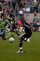 James Riley (l) of the Seattle Sounders defends a shot taken by  Rodney Wallace (r) of DC United in the match played on June 17, 2009 at Quest Field in Seattle, WA. The Sounders and United played to a 3-3 draw.
