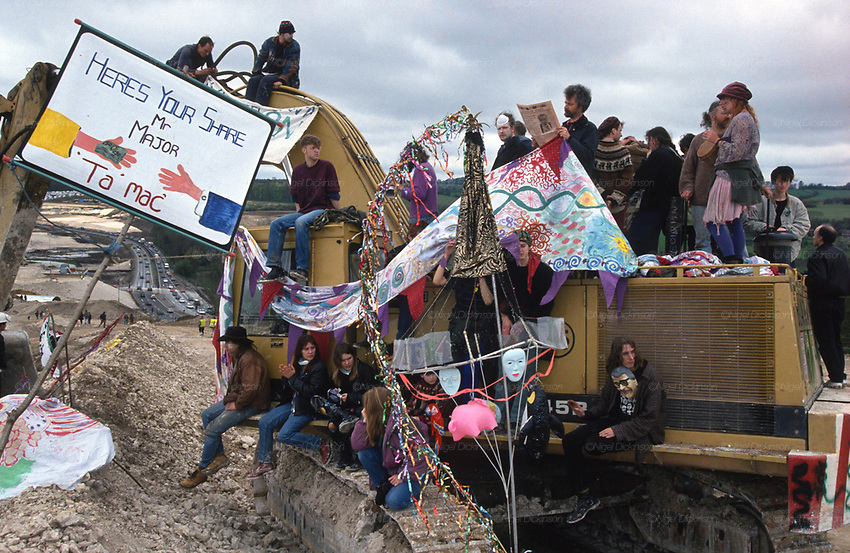 Occupying a Cat Caterpillar overlooking the M3 road. Road Protest actions at Twyford Down, near the Donga pathways, outside Winchester, against the M3 road extension. 1992-94<br />