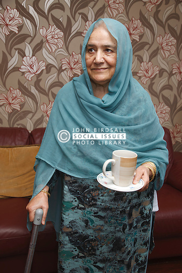 Elderly South Asian lady.