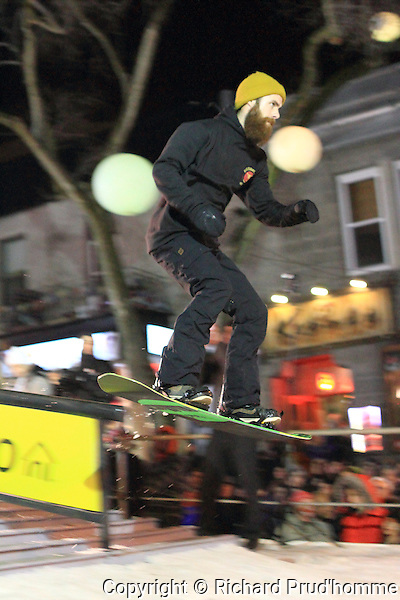 A snowboarder competes in the Empire City Troopers urban snowboard event in montreal