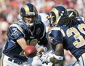Landover, MD - October 12, 2008 -- St. Louis Rams quarterback Marc Bulger (10) hands off to running back Steven Jackson (39) in game action against the Washington Redskins at FedEx Field in Landover, Maryland on Sunday, October 12, 2008.  The Rams won the game 19 -17..Credit: Ron Sachs / CNP