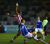 Lincoln City's John Akinde battles with Exeter City's Kane Wilson<br /> <br /> Photographer Andrew Vaughan/CameraSport<br /> <br /> The EFL Sky Bet League Two - Lincoln City v Exeter City - Tuesday 26th February 2019 - Sincil Bank - Lincoln<br /> <br /> World Copyright © 2019 CameraSport. All rights reserved. 43 Linden Ave. Countesthorpe. Leicester. England. LE8 5PG - Tel: +44 (0) 116 277 4147 - admin@camerasport.com - www.camerasport.com