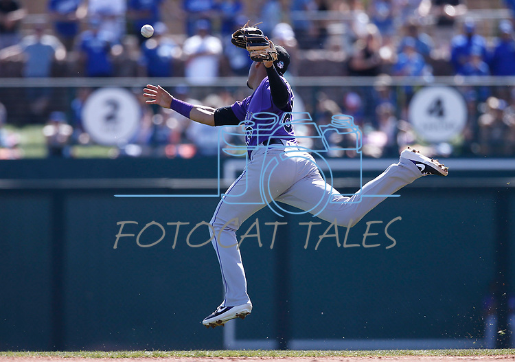 Colorado Rockies' Alan Trejo leaps for a ball hit during a spring training game against the Los Angeles Dodgers, in Glendale, Ariz., on Saturday, March 7, 2020. The Dodgers won 7-1.<br /> Photo by Cathleen Allison/Cathleen Allison Photography
