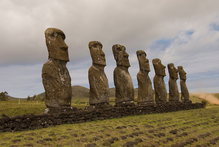 Chile, Easter Island: Statues or moai on a platform or ahu at Ahu Akivi, an inland array of moai, unusual because most moai face inland from the edge of the sea..Photo #: ch298-33150..Photo copyright Lee Foster www.fostertravel.com lee@fostertravel.com 510-549-2202