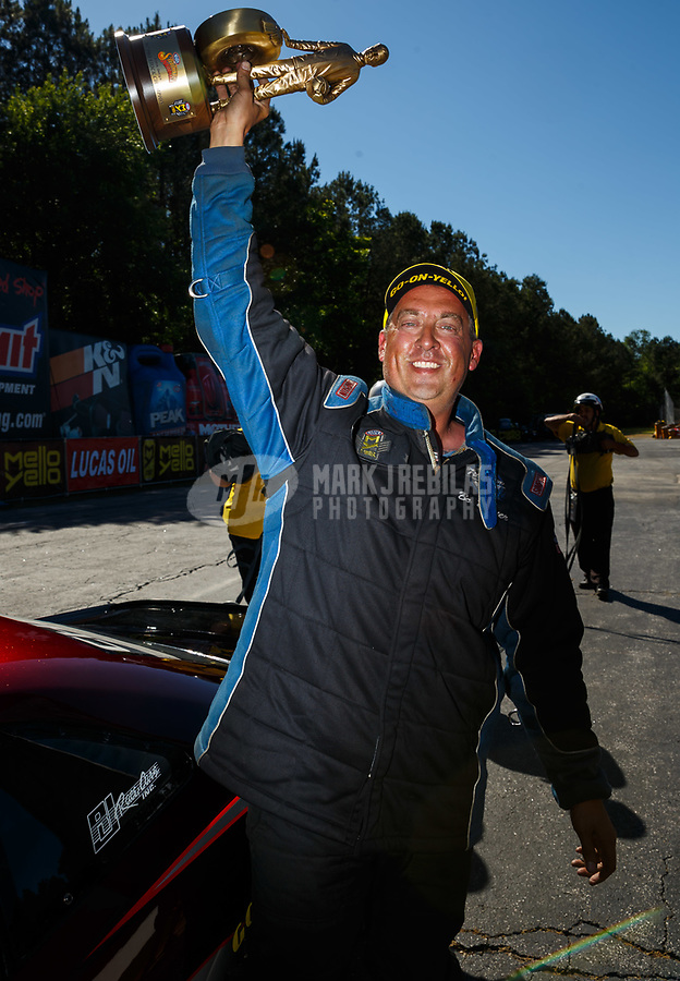 May 7, 2017; Commerce, GA, USA; NHRA pro stock driver Bo Butner celebrates after winning the Southern Nationals at Atlanta Dragway. Mandatory Credit: Mark J. Rebilas-USA TODAY Sports
